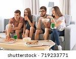 friends watching tv at home | Shutterstock . vector #719233771