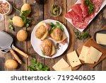 baked potato with raclette... | Shutterstock . vector #719240605