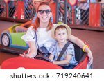 mother and child riding a car... | Shutterstock . vector #719240641