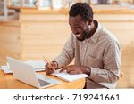 overjoyed man planning his... | Shutterstock . vector #719241661