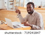 charming man posing while... | Shutterstock . vector #719241847