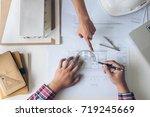 architect working on blueprint  ... | Shutterstock . vector #719245669
