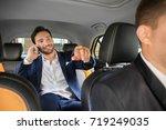 handsome man talking on phone... | Shutterstock . vector #719249035