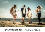 group of friends partying and... | Shutterstock . vector #719267071