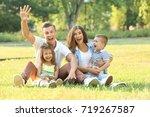 happy family in park | Shutterstock . vector #719267587