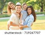 happy family in park | Shutterstock . vector #719267707