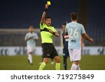 Small photo of Italy, Rome, September 20, 2017:Refree admonish Radu in action during the football match Serie A Lazio vs Napoli in Olimpic Stadium in Rome on 20 September 2017.