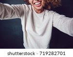 curly haired girl with freckles ... | Shutterstock . vector #719282701