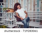 curly haired girl with freckles ... | Shutterstock . vector #719283061