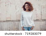 curly haired girl with freckles ... | Shutterstock . vector #719283079