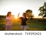 shot of two female golfers... | Shutterstock . vector #719292421