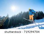 professional skier jumping in... | Shutterstock . vector #719294704
