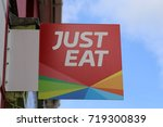 Small photo of Aberaeron, Ceredigion, Wales, UK. 19 September 2017. Just Eat store sign.
