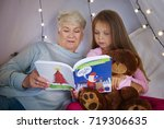granddaughter with grandmother... | Shutterstock . vector #719306635