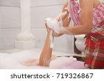 woman having foam massage in... | Shutterstock . vector #719326867