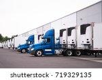 a day cab big rigs semi trucks... | Shutterstock . vector #719329135