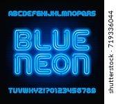 blue neon tube alphabet font.... | Shutterstock .eps vector #719336044