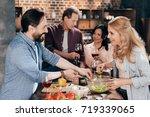 cheerful mature friends... | Shutterstock . vector #719339065