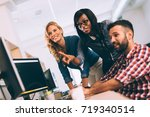 software engineers working on... | Shutterstock . vector #719340514