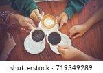 closeup of hands with coffee... | Shutterstock . vector #719349289