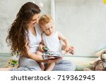 mother with child playing... | Shutterstock . vector #719362945