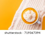 pumpkin latte with spices.... | Shutterstock . vector #719367394