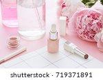 cosmetics bottles on the pink... | Shutterstock . vector #719371891