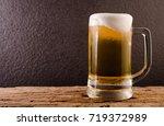 beer in mug on wooden table... | Shutterstock . vector #719372989
