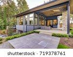 new modern home features a... | Shutterstock . vector #719378761