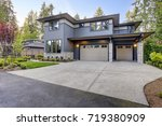 new construction home exterior... | Shutterstock . vector #719380909