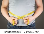 the abdomen is fat  on a gray... | Shutterstock . vector #719382754