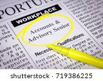 Small photo of Accounts & Advisory Senior - Newspaper sheet with ads and job search, circled with yellow marker, Blurred image and selective focus