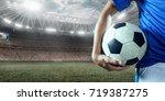 soccer player holds a soccer... | Shutterstock . vector #719387275