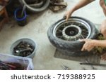 Small photo of blurred photo,Motorcycle repair after a tire leak during a long journey. Modifying some parts of a motorcycle when it is used for a certain period of time by an expert technician.