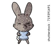 curious bunny cartoon   Shutterstock .eps vector #719391691