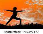 outdoor woman yoga silhouette. | Shutterstock . vector #719392177