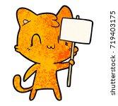 cartoon happy cat with blank...   Shutterstock .eps vector #719403175