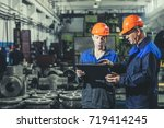 two workers at an industrial... | Shutterstock . vector #719414245