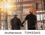 two engineers working in a... | Shutterstock . vector #719432641