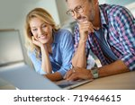 mature couple connected with... | Shutterstock . vector #719464615
