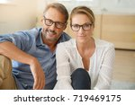 mature couple with eyeglasses... | Shutterstock . vector #719469175