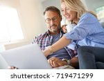 mature couple connected on... | Shutterstock . vector #719471299