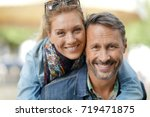 man giving piggyback ride to... | Shutterstock . vector #719471875