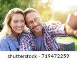 portrait of cheerful mature... | Shutterstock . vector #719472259