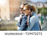 couple of tourists enjoying... | Shutterstock . vector #719472271