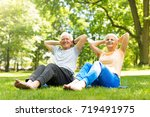 senior couple exercising in... | Shutterstock . vector #719491975