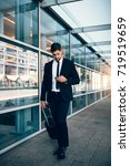 handsome businessman using... | Shutterstock . vector #719519659