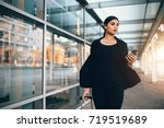 beautiful young businesswoman... | Shutterstock . vector #719519689