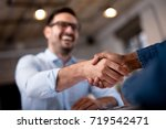 business people shaking hands. | Shutterstock . vector #719542471