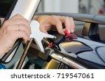 repairing car dent after the... | Shutterstock . vector #719547061